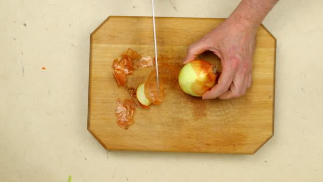 Peeling an onion.