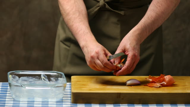 Peeling and chopping shallot.