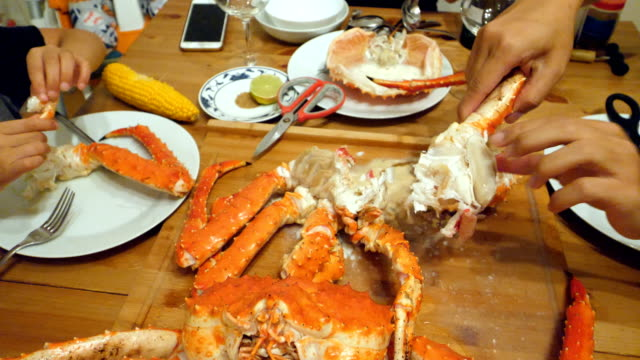 peeling and cutting a crab - prawn seafood stock videos & royalty-free footage