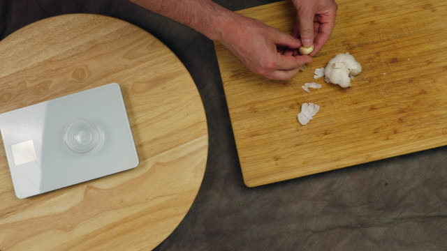 Peeling and weighing garlic cloves