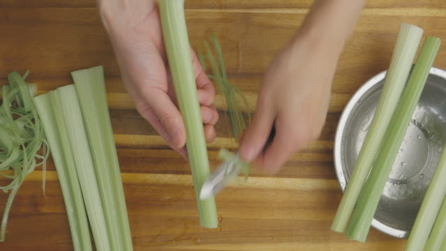 peeling celery stick skin - peel stock videos & royalty-free footage