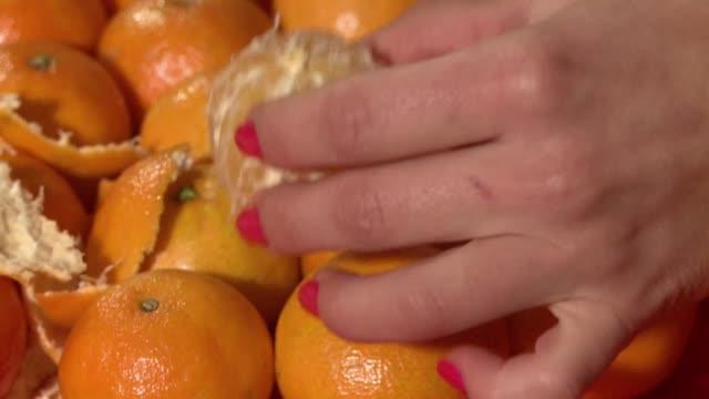 peeling mandarin - peel stock videos & royalty-free footage