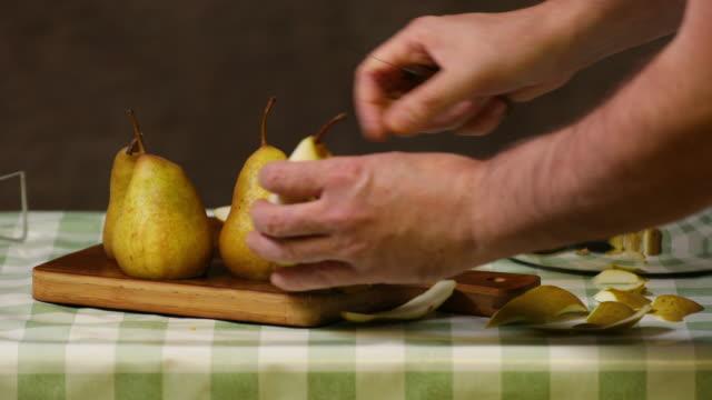 peeling pears and putting them in pressure cooker. - annick vanderschelden stock videos & royalty-free footage