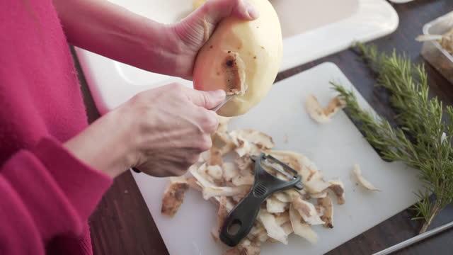 peeling potatoes in the kitchen - peel stock videos & royalty-free footage