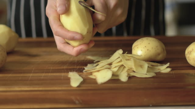peeling potatoes - peeling food stock videos & royalty-free footage