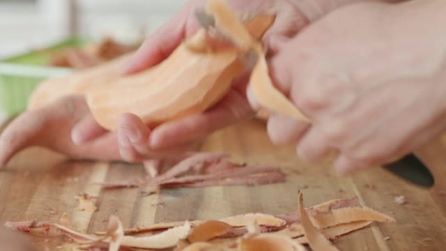 peeling  sweet potatoes - sweet potato stock videos & royalty-free footage