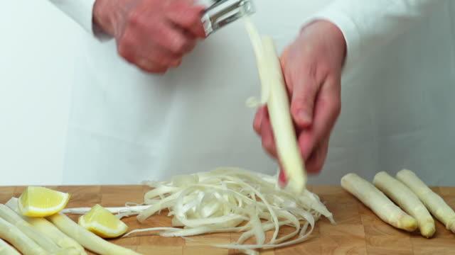 peeling white asparagus (4:2:2@100 mb/s) - peeling food stock videos & royalty-free footage