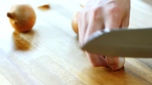 peeling white onion