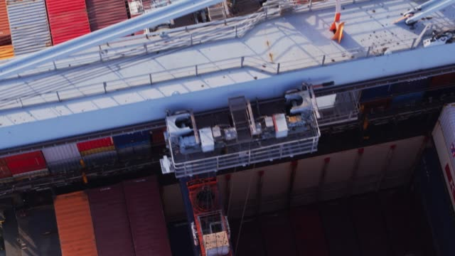 Peering Down Into Bowels of Cargo Ship - Drone Shot