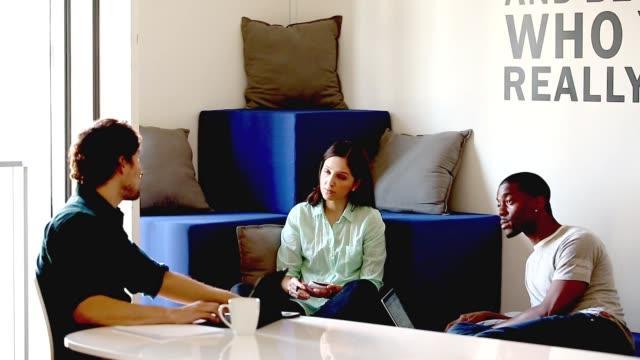 peers brainstorming in office environment - casual clothing stock videos & royalty-free footage