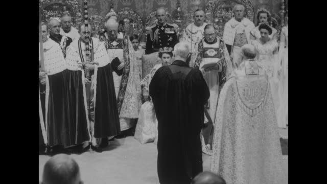 Peers / James PittWatson Moderator of the Church of Scotland presents Elizabeth II with the church bible / Elizabeth seated flanked by William...