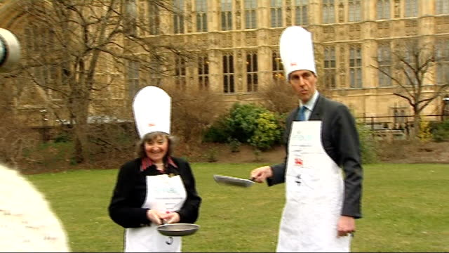 peers mps and representitives of the media take part in pancake tossing race at westminster england london westminster ext channel 4 news political... - pancake stock videos & royalty-free footage