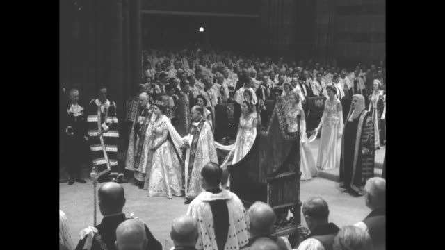 peers stand in westminster abbey / queen elizabeth ii walks up aisle accompanied by michael ramsey bishop of durham and harold bradfield bishop of... - coronation stock videos and b-roll footage