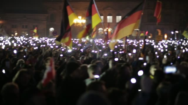 Pegida rally reflects rise in rightwing radicalism GERMANY Saxony Dresden Pegida rally with participants singing SOT People holding up lights