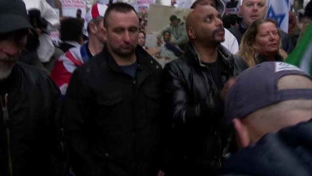 Tommy Robinson interview / general views Various shots of Pegida supporters / man wearing Tshirt with slogan 'Enoch Powell Was Right' / placards...