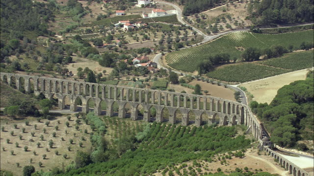 aerial ws pan zi pegoes aqueduct / tomar, santarem, portugal - aqueduct stock videos and b-roll footage