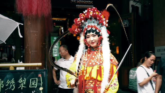 peking opera costume performer in ciqikou ancient town,chongqing,china. - performance stock videos & royalty-free footage