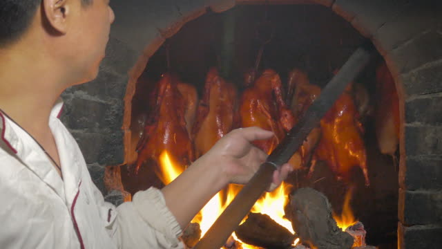 peking roast duck in stone oven, beijing, china - duck stock videos and b-roll footage