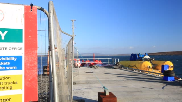 pelamis p2 wave energy generator on the dockside at lyness on hoy, orkney isles, scotland, uk. the orkney's have huge potential for wave and tidal... - hoy stock videos & royalty-free footage