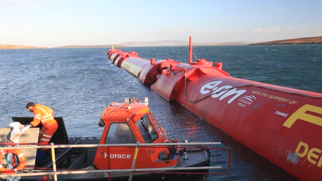 pelamis p2 wave energy generator on the dockside at lyness on hoy, orkney isles, scotland, uk. the orkney's have huge potential for wave and tidal... - innovation stock videos & royalty-free footage