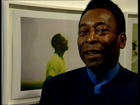 pele opens london photography exhibition; itn pele interviewed sot - multiple peles was surprise, i wish we had same number of peles in national team... - exhibition stock videos & royalty-free footage