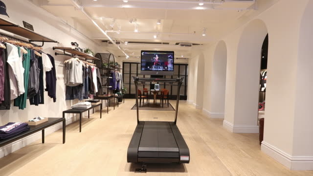 peloton treadmill at peloton show room in manhattan, new york state, new york city, usa on wednesday, december 18, 2019. - exercise bike stock videos & royalty-free footage