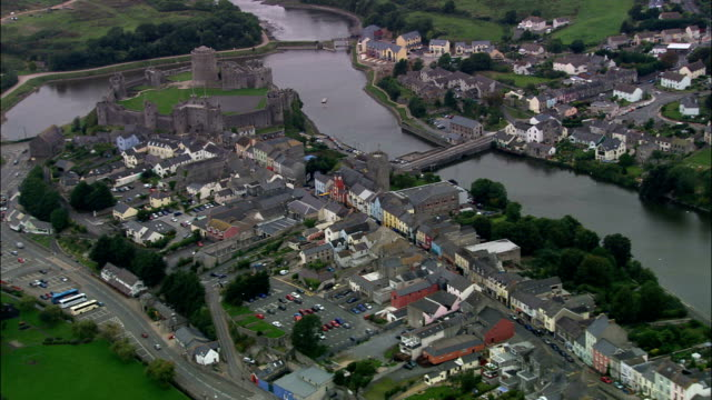 pembroke castle and town  - aerial view - wales, county of pembrokeshire, pembroke, united kingdom - pembrokeshire stock videos and b-roll footage