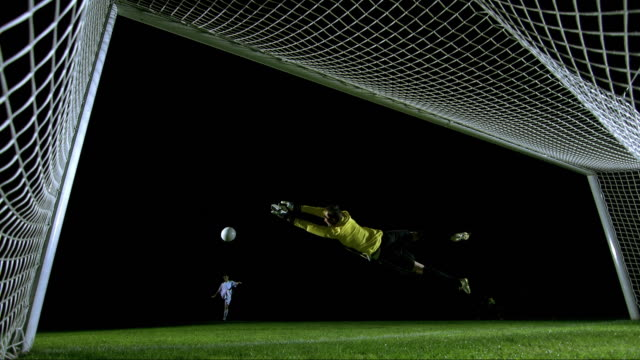 penalty kick, behind the goal view, timeramp - tor konstruktion stock-videos und b-roll-filmmaterial