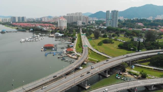 penang bridge for malaysian people transportation - penang bridge stock videos and b-roll footage