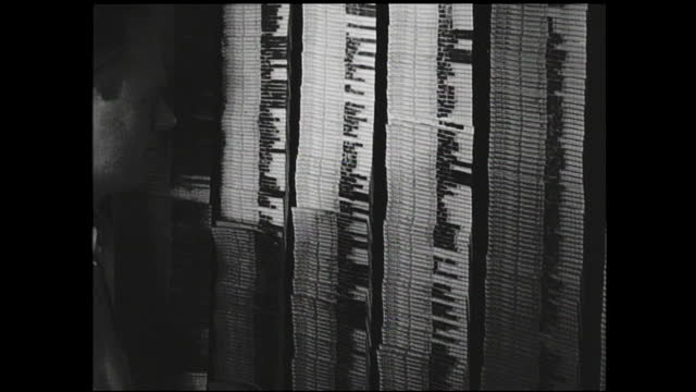 pencil pointing at cards and man removing and organizing labels on the scheduling board - 1940 1949 bildbanksvideor och videomaterial från bakom kulisserna