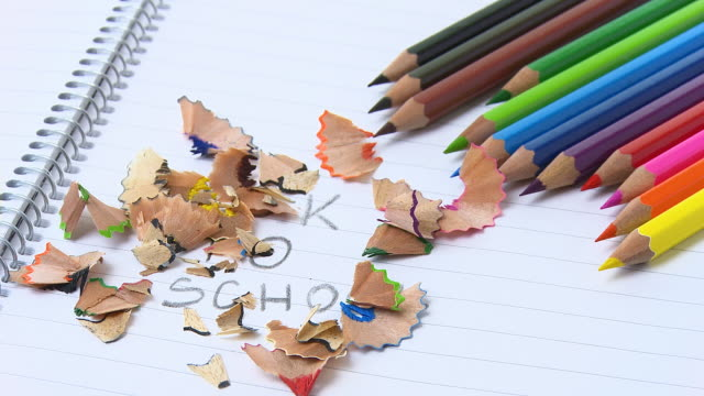 hd time lapse: pencil shavings over message text - pencils in a row stock videos & royalty-free footage