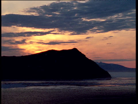 peninsula silhouetted at sunset, talan island - peninsula stock videos & royalty-free footage