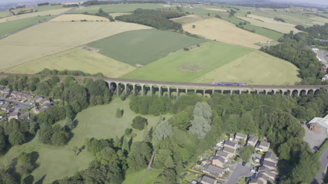 penistone viaduct train crossing 4k aerial video - rail transportation stock videos & royalty-free footage
