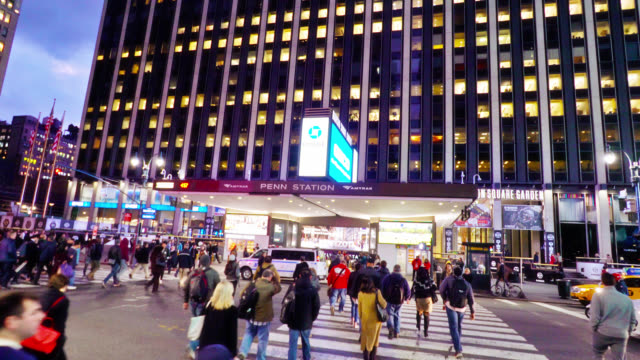 penn station and madison square garden. tourists walk by. large entertainment center. crowd of people. new york, us - entrance sign stock videos & royalty-free footage