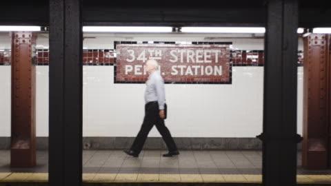 penn station subway establishing shot - handheld shot - new york city - underground station platform stock videos & royalty-free footage