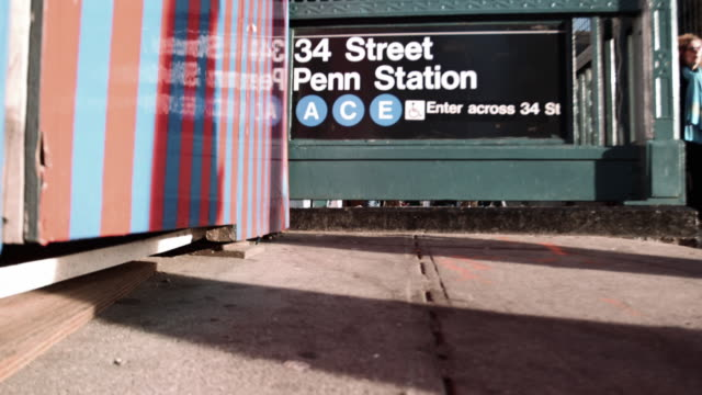 penn station subway station entrance at rush hour - new york city penn station stock videos & royalty-free footage