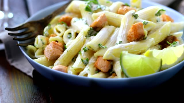 penne with grilled salmon and herbs - grilled salmon stock videos & royalty-free footage