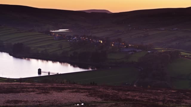 pennine reservoir after sunset - drone shot - west yorkshire stock videos & royalty-free footage