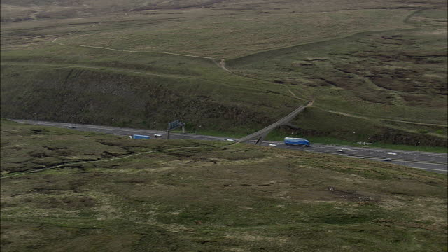 pennine way crossing m62 at moss moor  - aerial view - england,  helicopter filming,  aerial video,  cineflex,  establishing shot,  united kingdom - pennines stock videos and b-roll footage
