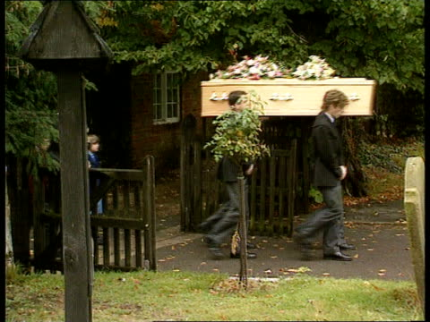 bucks denham st mary's church ms coffin carried along in procession as followed by penny's husband alistair bell children matthew lauren zoom ms... - funeral procession stock videos & royalty-free footage