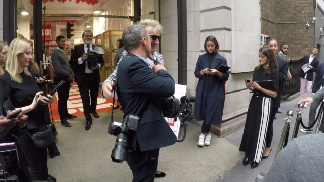 penny lancaster and rod stewart seen attending hello! magazine x dover street market - anniversary party on may 09, 2018 in london, england. - rod stewart stock-videos und b-roll-filmmaterial