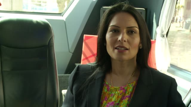 penny mordaunt and priti patel interviews ext penny mordaunt and priti patel posing for photos outside battle bus priti patel interview sot doesn't... - priti patel stock-videos und b-roll-filmmaterial