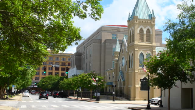 Pensacola Florida historical city traffic and church on Palafox Street downtown