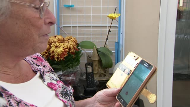 pension cold calling to be banned england int pat bottomley holding smart phone and landline telephone ringing pat bottomley interview sot bottomley... - landline phone stock videos & royalty-free footage