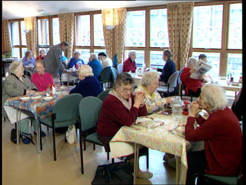 pension overhaul lib old people sat in dining room in care home reading papers and magazines - dining room stock videos & royalty-free footage