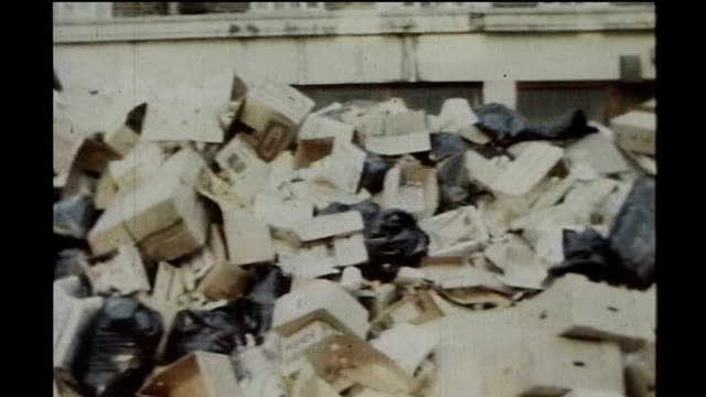 trade unions to ballot members on strike action tx piles of uncollected rubbish in street pan workmen on strike gathered around brazier fire on... - pension stock videos & royalty-free footage
