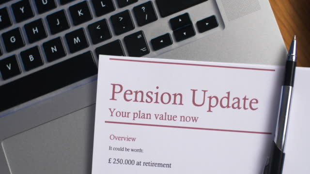 pension update with laptop computer - pension stock videos & royalty-free footage