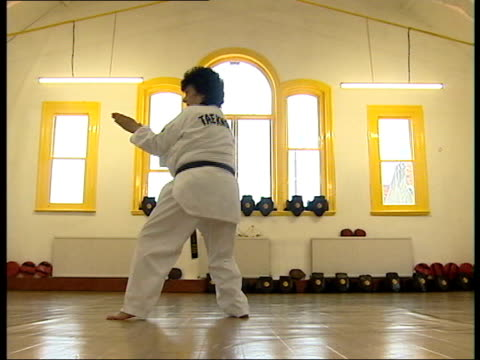 england pensioners' lifestyles itn pensioner alma cullen in gymn practicing tae kwondo alma cullen interviewed sot i did teaching 'til i was 65 but... - bournemouth england stock videos & royalty-free footage