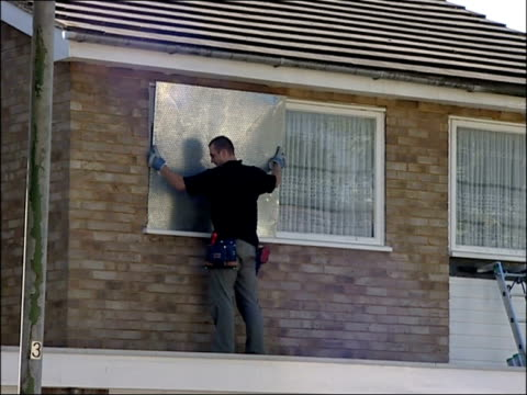 pensioner evicted in leighonsea after being ordered to pay court costs lib ext bailiffs putting steel shutters on house windows - shutter stock videos & royalty-free footage