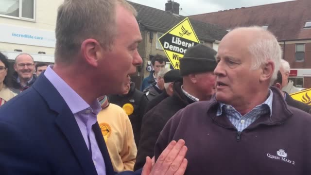 pensioner malcolm baker confronts tim farron during a campaign visit in kidlington, oxfordshire. - oxfordshire stock videos & royalty-free footage